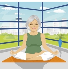 Woman doing yoga exercises in lotus position vector