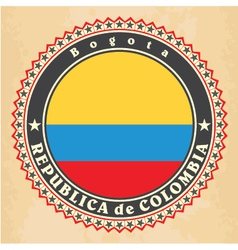 Vintage label cards of Colombia flag vector image vector image
