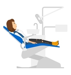 Patient in dental chair vector