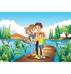 Family standing on the bridge vector image