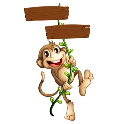 A monkey holding the two wooden signboards vector image vector image