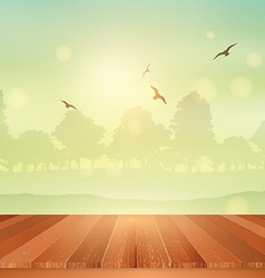 Wooden table looking out to sunny landscape vector