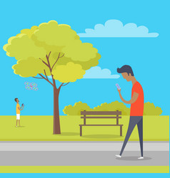 Boy with smartphone on walk in park out of town vector