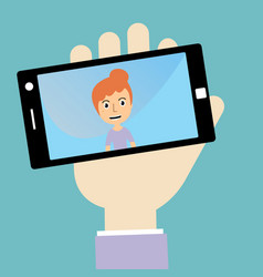 Womans hand holding smartphone with self portrait vector