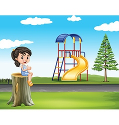 Girl sitting on log at the park vector