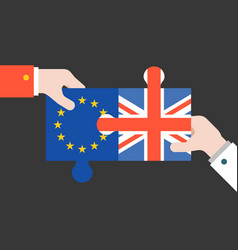 hand holding britain and euro jigsaw puzzle vector image