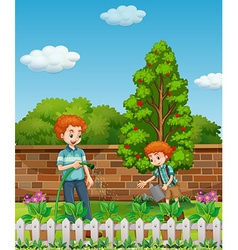 Father and son watering plants in the garden vector