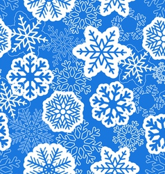 Blue seamless christmas background with snowflakes vector