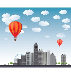 Hot air balloons flying over the town vector image
