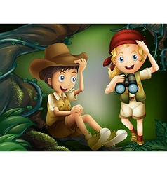 A jungle with a boy and a girl vector image