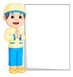 happy muslim boy cartoon holding blank sign vector image