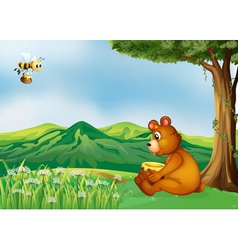 A bear sitting near a tree vector image