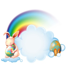 A bunny hugging an easter egg near the rainbow vector image