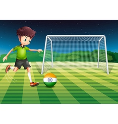 An athlete kicking the ball with the flag of india vector
