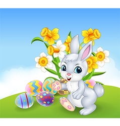 Cartoon happy bunny with colourful easter eggs vector