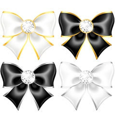 White and black bows with diamonds and gold edging vector