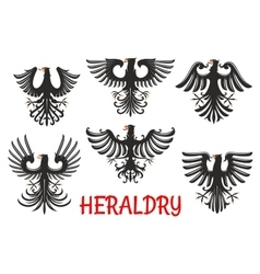 Heraldic black eagles with raised wings vector