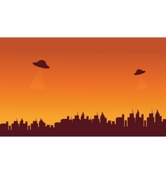 Silhouette oof city and ufo in sky vector