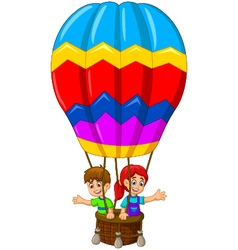 Funny two kids cartoon flying in a hot air balloon vector