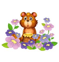 A bear holding a honey in the flower garden vector image