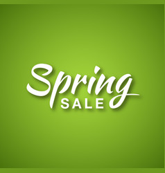 Spring sale calligraphic text on green background vector