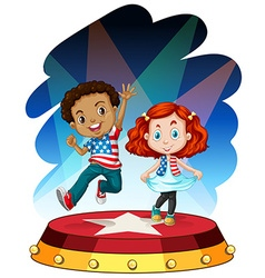 Boy and girl performing on stage vector