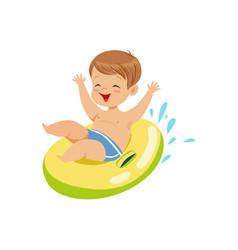 cute boy having fun floating with lifebuoy vector image vector image