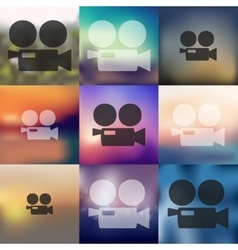 Movie camera icon on blurred background vector