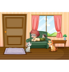 A young boy and his cats inside the house vector