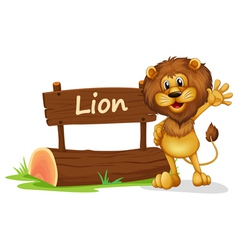 A lion standing beside a wooden signage vector image