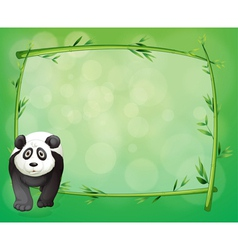 A big panda beside a bamboo frame vector image