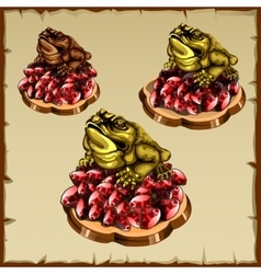 Three frog figurines sitting on ruby vector