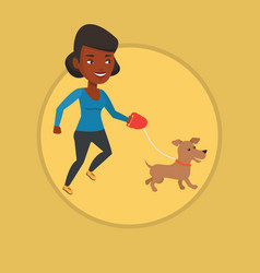 Young woman walking with her dog vector