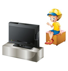A boy watching tv vector