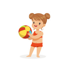 Little girl wearing red swimsuit playing with a vector