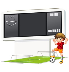 A boy playing soccer at the court vector image vector image