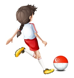 A female athlete kicking the ball with the flag of vector image