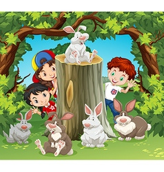 Children in the jungle with rabbits vector image