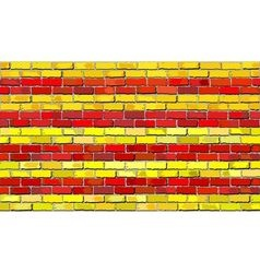 Grunge flag of catalonia on a brick wall vector
