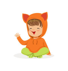 Sweet smiling little girl dressed in fox sweater vector