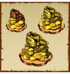 Three frog figurines sitting on gold vector