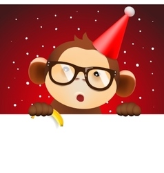 Cute monkey holding white page christmas card vector