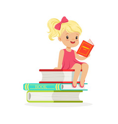 Beautiful blonde girl in pink dress reading a on vector