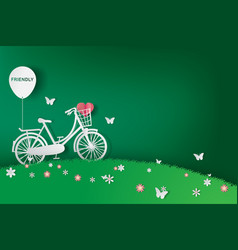 paper art of green background with bicycle in the vector image