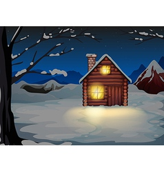 A lighted log house at the snowy land vector