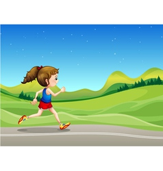A girl running in the street near the hills vector