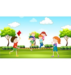 Kids playing piggy back ride in the park vector image