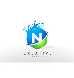 N letter logo blue green splash design vector