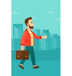 Businessman walking with briefcase vector