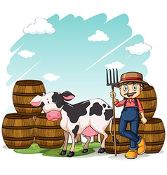 Farmer beside the cow vector image